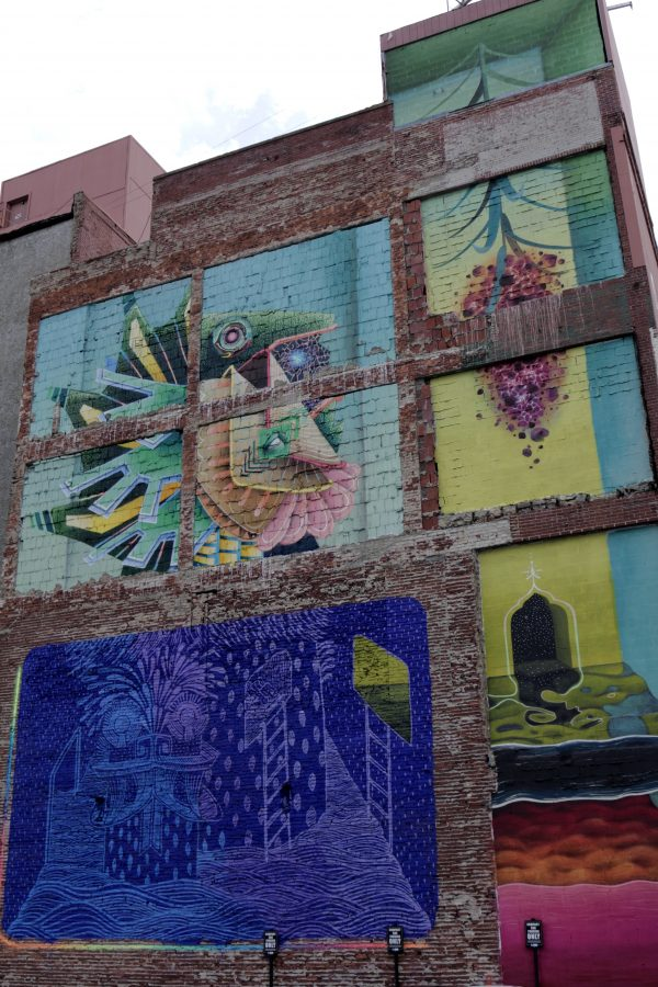 More Nashville Murals You Should Visit | Greta Hollar - 32 More Nashville Murals You Should Visit by popular Nashville blogger Greta Hollar: image of large building mural in Nashville, Tennessee.