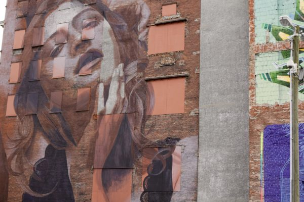 More Nashville Murals You Should Visit | Greta Hollar - 32 More Nashville Murals You Should Visit by popular Nashville blogger Greta Hollar: image of large building mural of a woman in Nashville, Tennessee.