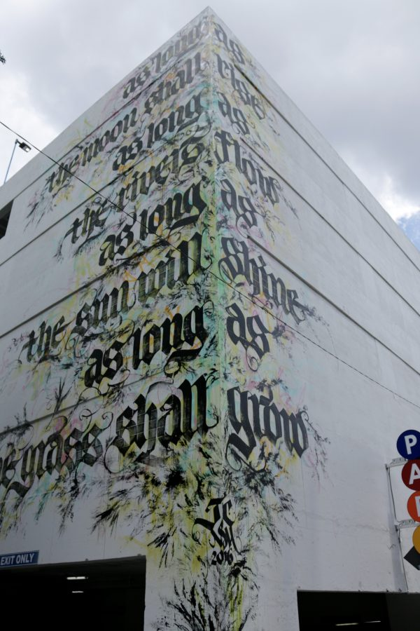 More Nashville Murals You Should Visit | Greta Hollar - 32 More Nashville Murals You Should Visit by popular Nashville blogger Greta Hollar: image of Johnny Cash lyrics mural in Nashville, Tennessee.