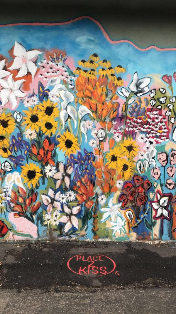 More Nashville Murals You Should Visit | Greta Hollar - 32 More Nashville Murals You Should Visit by popular Nashville blogger Greta Hollar: image of floral mural in Nashville, Tennessee.