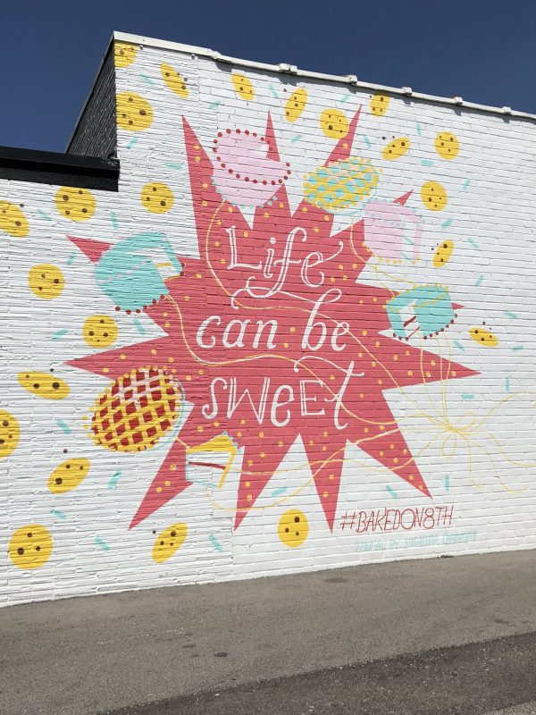 32 More Nashville Murals You Should Visit by popular Nashville blogger Greta Hollar: image of baked on 8th building mural in Nashville, Tennessee.