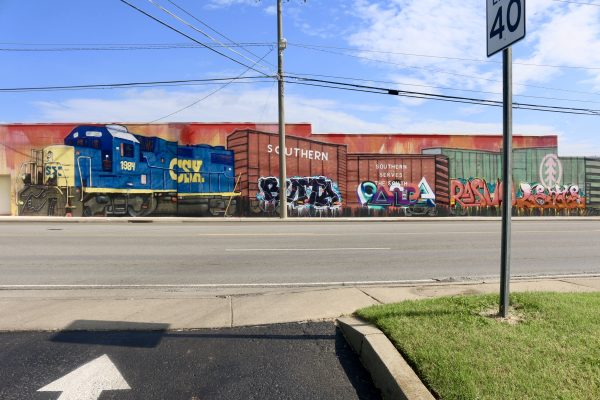 More Nashville Murals You Should Visit | Greta Hollar | 32 More Nashville Murals You Should Visit by popular Nashville blogger Greta Hollar: image of train mural in Nashville, Tennessee.