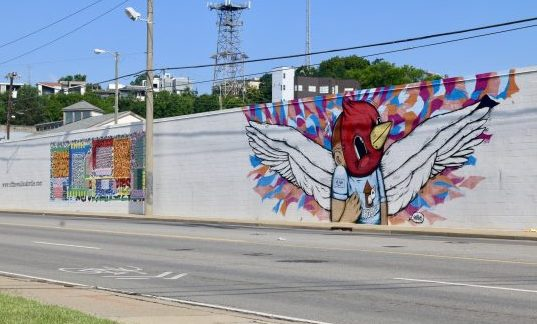 More Nashville Murals You Should Visit | Greta Hollar | 32 More Nashville Murals You Should Visit by popular Nashville blogger Greta Hollar: image of building mural in Nashville, Tennessee.