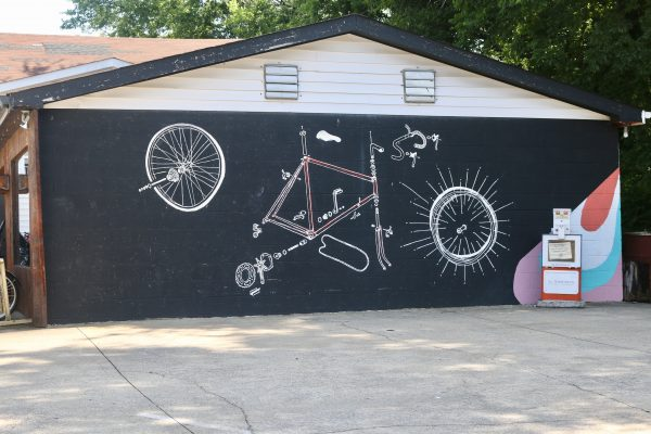 More Nashville Murals You Should Visit | Greta Hollar | 32 More Nashville Murals You Should Visit by popular Nashville blogger Greta Hollar: image of bike shop mural in Nashville, Tennessee.