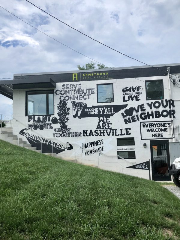 71 More Nashville Murals You Should Visit | Greta Hollar | 32 More Nashville Murals You Should Visit by popular Nashville blogger Greta Hollar: image of building mural in Nashville, Tennessee.