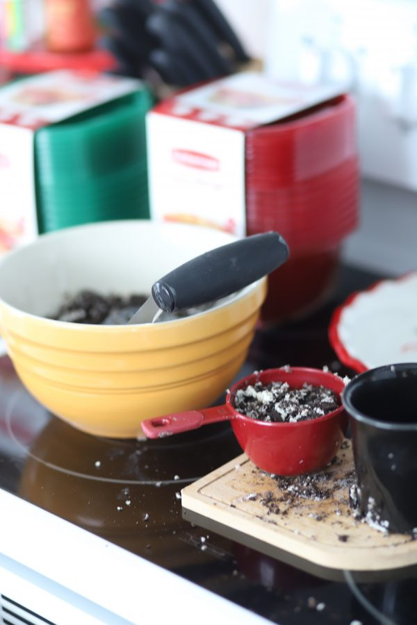 Oreo Balls Recipe + Giving Back During the Holidays   Greta Hollar   Easy Oreo Balls Recipe featured by top Nashville lifestyle blogger, Greta Hollar: picture of a baking bowl with oreos in a measuring cup