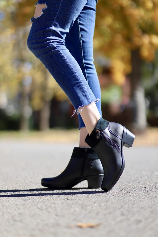 The Holiday Gift Everyone Needs from Kohl's | Greta Hollar | The Best Kohl's Gifts featured by top Nashville fashion blogger, Greta Hollar: image of a woman wearing Clarks black booties, available at Kohl's
