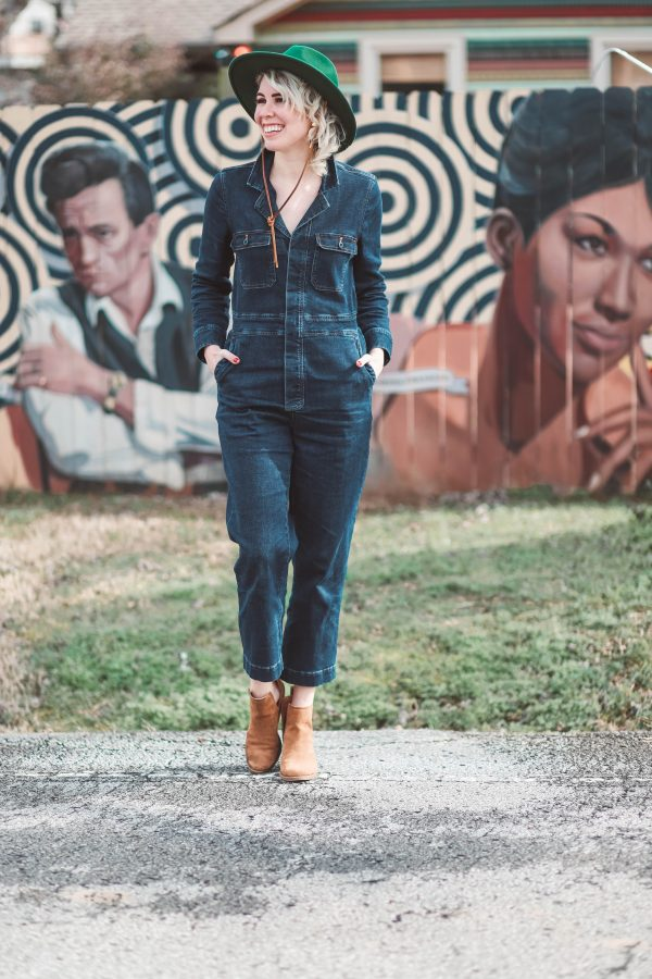 Cute Winter Looks featured by top US fashion blogger Greta Hollar; Image of a woman wearing Madewell jumpsuit, Urban Outfitters hat, Steve Madden shoes and Target earrings