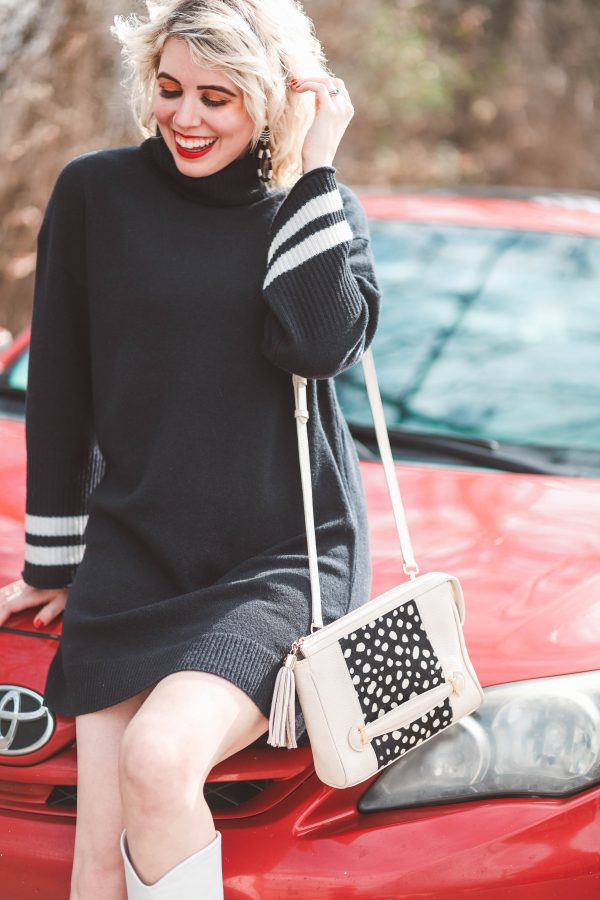 Cute Winter Looks featured by top US fashion blogger Greta Hollar; Image of a woman wearing Madewell dress, GiGi New York bag, Marc Fisher boots and Target earrings.