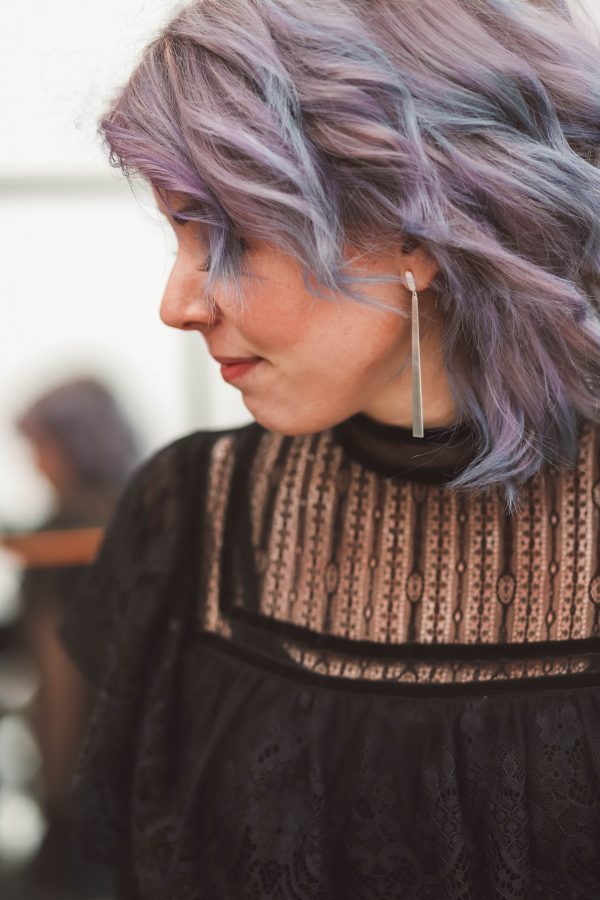 Kristin Ess Temporary Tint featured by top US beauty blogger Greta Hollar; Image of a woman with purple hair.