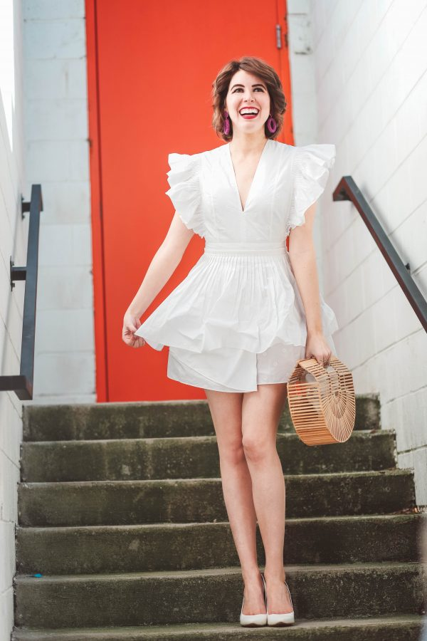 Jergens Natural Glow featured by top US beauty blogger Greta Hollar; Image of a woman wearing a white dress.