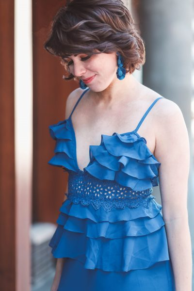 The Blue Ruffle Dress for Your Next Formal Event featured by top US fashion blog, Greta Hollar; image of woman wearing a shopbop dress, Target earrings and blowout by Darling Nashville