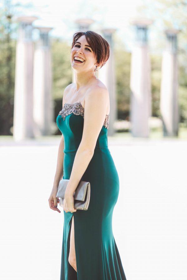 Faviana Dress featured by top US fashion blogger Greta Hollar; Image of a woman wearing a green, strapless Faviana Dress.