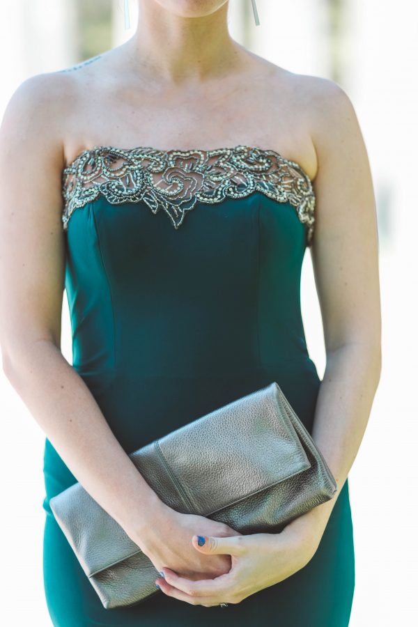 Faviana Dress featured by top US fashion blogger Greta Hollar; Image of a woman wearing a green, strapless Faviana Dress.