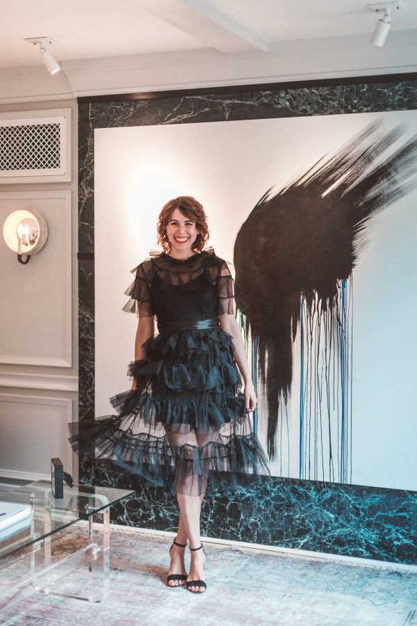 Kimpton Brice Hotel featured by top US travel blogger Greta Hollar; Image of a woman wearing a black ruffled dress.