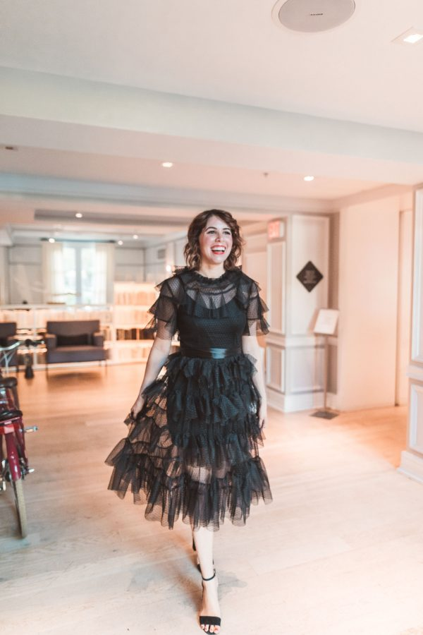 Black Ruffle Dress featured by top US fashion blogger Greta Hollar; Image of a woman wearing dress from Chicwish.