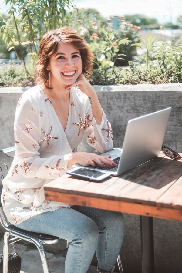 Working from Home Tips featured by top US life and style blogger Greta Hollar; Image of a woman wearing sequin top and jeans.