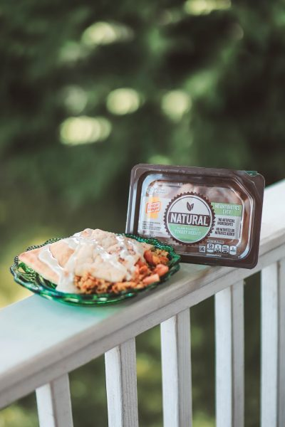 Easy Summer Turkey Pita | Greta Hollar | Easy Turkey Pita Sandwich Perfect for Summer by top US life and style blog, greta hollar: image of green glass plate, classic ranch dressing, oscar mayer natural slow roasted sliced turkey breast, and turkey pita sandwich.