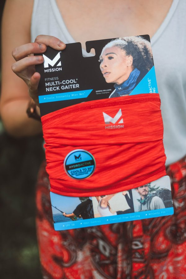 Festival Essentials featured by top Nashville life and style blogger Greta Hollar; Image of a woman wearing Mission Instant Cooling gear.
