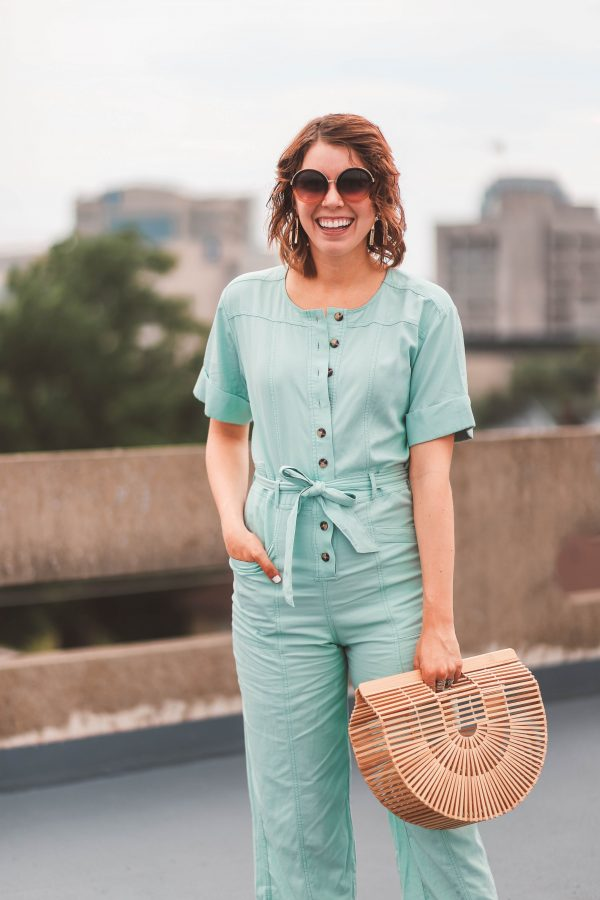 Madewell Jumpsuit featured by top US fashion blogger Greta Hollar; Image of a woman wearing a Madewell jumpsuit and Seychelles flats.