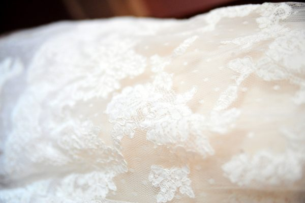 4th of July Wedding | Greta Hollar | 4th of July Wedding by popular lifestyle blogger Greta Hollar: close up image of lace on a The White Room tea length wedding dress.