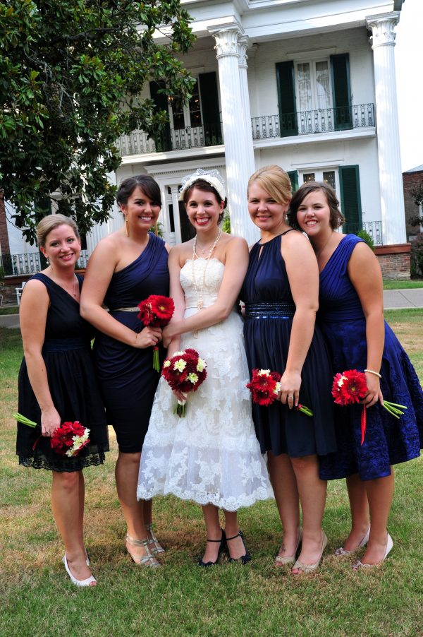 4th of July Wedding | Greta Hollar | 4th of July wedding by popular lifestyle blogger, Greta Hollar: image of bride wearing a The White Room tea length lace wedding dress, blue peep toe DSW heels, and a BHLDN bird cage veil with her 4 bridesmaids standing next to her.