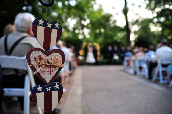 4th of July Wedding | Greta Hollar | 4th of July Wedding by popular lifestyle blogger Greta Hollar: image of three patriotic wooden hanging hearts.