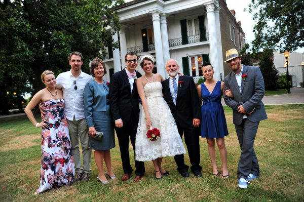 4th of July Wedding | Greta Hollar | 4th of July Wedding by popular lifestyle blogger Greta Hollar: image of a bride and groom standing with members of the groom's family outside of the Riverwood Mansion in Nashville, Tennessee.