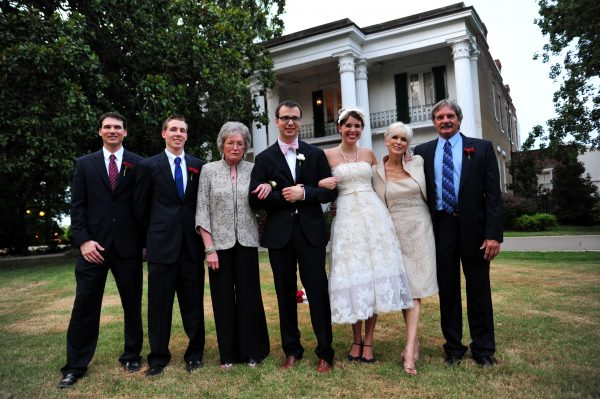 4th of July Wedding | Greta Hollar | 4th of July Wedding by popular lifestyle blogger Greta Hollar: image of a bride and groom standing with members of the bride's family outside the Riverwood Mansion in Nashville, Tennessee.