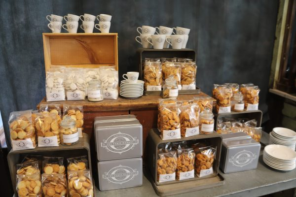 Savannah Travel Guide | Greta Hollar | The Ultimate Savannah Travel Guide by popular Nashville lifestyle blogger, Greta Hollar: image of white mugs, plates, and bagged cookies.