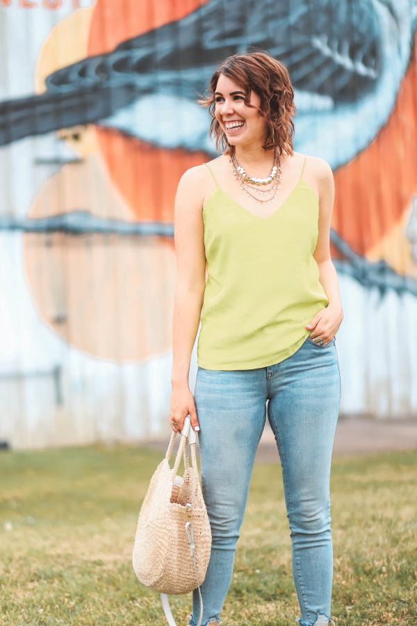 A Spray Tan & Neon Green | Greta Hollar | Top 4 Spring 2020 Fashion Trends to Wear by popular Nashville tall fashion blogger, Greta Hollar: image of a woman wearing a neon green top.
