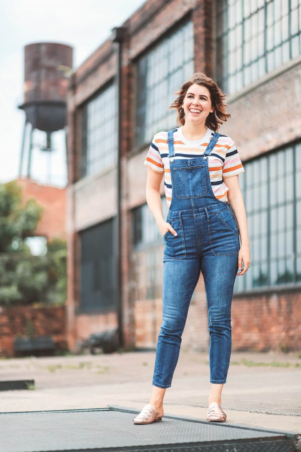Festival Shoes featured by top US fashion blogger Greta Hollar; Image of a woman wearing Seychelles shoes and denim overalls.