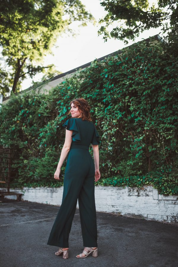The Jumpsuit You Need for an End of Summer Event   Greta Hollar   Have a Late Summer Event? Wear This Eliza J. Jumpsuit! by popular Nashville fashion blogger, Greta Hollar: image of a woman wearing a Eliza J. Flutter Sleeve Belted Satin Jumpsuit.