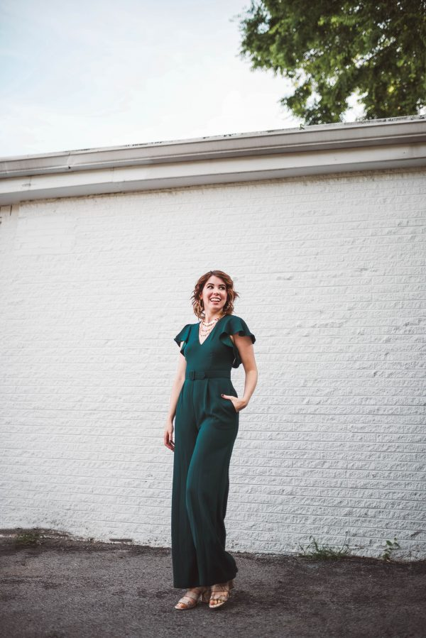 The Jumpsuit You Need for an End of Summer Event | Greta Hollar | Have a Late Summer Event? Wear This Eliza J. Jumpsuit! by popular Nashville fashion blogger, Greta Hollar: image of a woman wearing a Eliza J. Flutter Sleeve Belted Satin Jumpsuit.