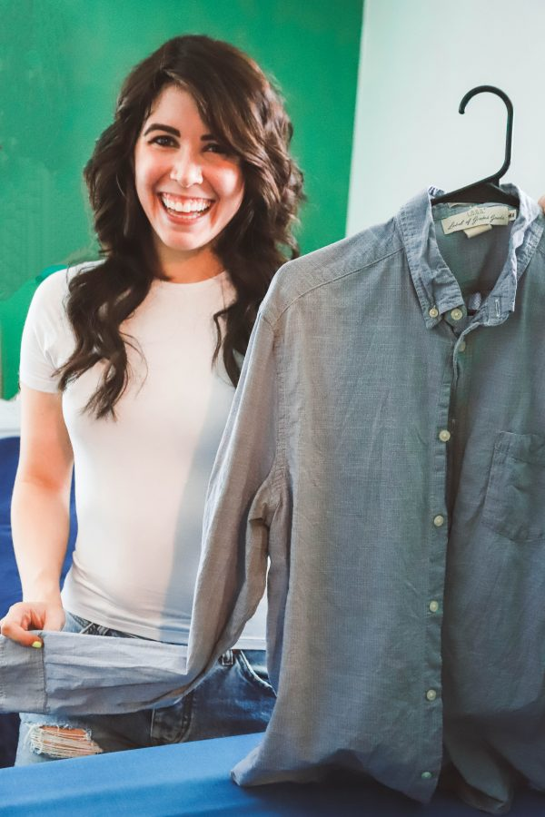 How to Get Ready for the Week on Sunday | Greta Hollar | How to Get Ready for the Week on Sunday by popular Nashville lifestyle blogger, Greta Hollar: image of a woman holding up a hanger with a non-wrinkled button down shirt on it.