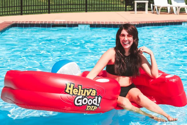 Taking a Dip with Heluva Good! Dip | Greta Hollar | Taking a Dip with Heluva Good! Dip by popular Nashville life and style blogger, Greta Hollar: image of a woman floating in a pool in a red Heluva Good! Dip pool float.
