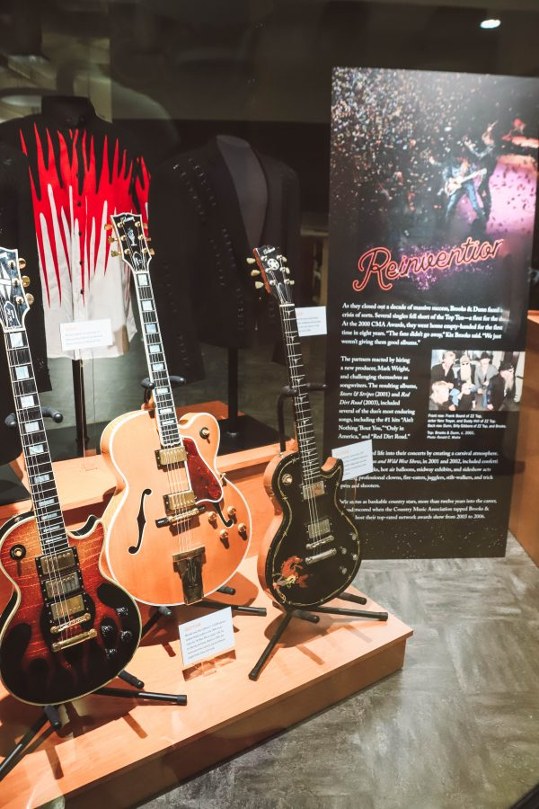 Troubadour Membership at The Country Music Hall of Fame and Museum | Greta Hollar | Troubadour Membership at The Country Music Hall of Fame and Museum in Nashville by popular Nashville blogger, Greta Hollar: image of 3 guitars at the Country Music Hall of Fame and Museum