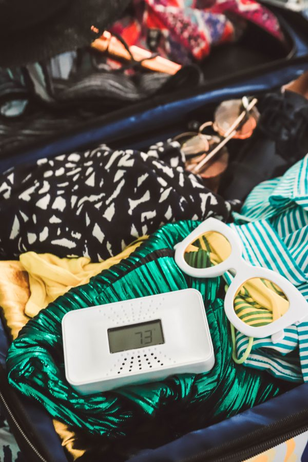 The One Thing I'm Packing for My End of Summer Vacation? My First Alert CO Alarm! | Greta Hollar | The One Thing I'm Packing for My End of Summer Vacation? My First Alert CO Alarm! by popular Nashville life and style blogger, Greta Hollar: image of a First Alert CO alarm on top of some clothes in a suitcase.