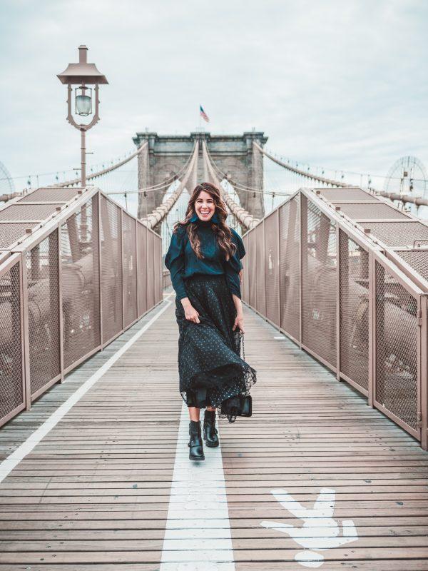5 of My Street Style Looks from NYFW | Greta Hollar | NYFW Street Style by popular Nashville fashion blogger, Greta Hollar: image of a woman outside on the Brooklyn Bridge in New York City.