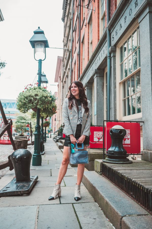 My Must-Have Shopbop Pieces for Fall | Greta Hollar | My Must-Have Shopbop Favorites for Fall by popular Nashville fashion blogger, Greta Hollar: image of a woman outside wearing a Shopbop faux leather skit, Shopbop blazer, Shopbop graphic print shirt, and holding a Shopbop purse.