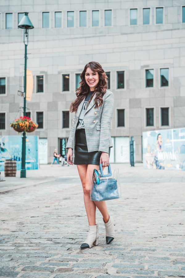 Two Ways to Style Faux Leather Clothing by popular Nashville fashion blogger, Greta Hollar: image of woman outside in New York City wearing a BB Dakota Keep Livin Vegan Leather Skirt, Lioness The Palermo Blazer, ANINE BING Paint It Bing Tee, STAUD Shirley Bag, and Nordstrom Seychelles No One Like You Bootie, Main, color, BLACK LEATHER No One Like You Bootie.