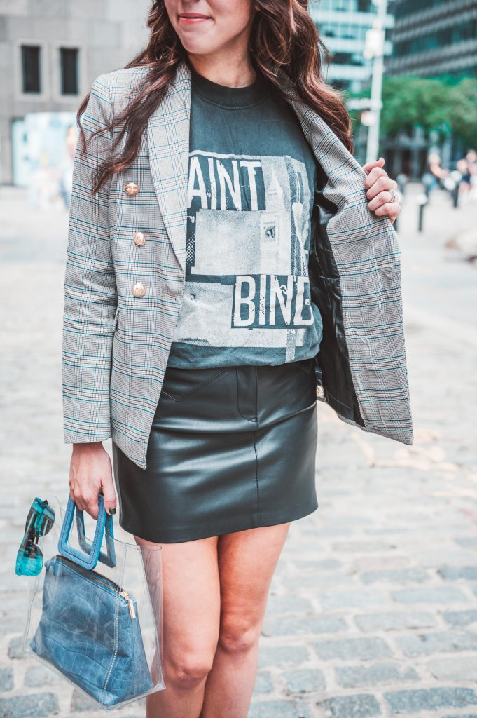 Two Ways to Style Faux Leather Pieces | Greta Hollar | Graphic Tees by popular Nashville tall fashion blogger, Greta Hollar: image of Greta Hollar wearing a graphic tee with a plaid blazer and faux leather skirt.