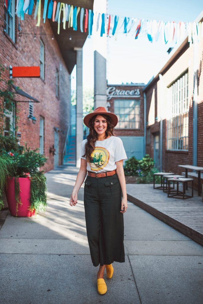Spray Tanning Tips & Tricks | Greta Hollar | Graphic Tees by popular Nashville tall fashion blogger, Greta Hollar: image of Greta Hollar wearing a cactus print graphic tee with culottes pants and yellow suede mules.