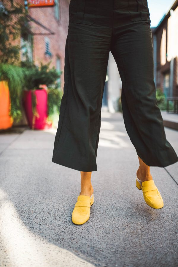 Fall Footwear at NYFW | Greta Hollar | Spray Tanning Tips & Tricks by popular Nashville beauty blogger, Greta Hollar: image of a woman standing outside.