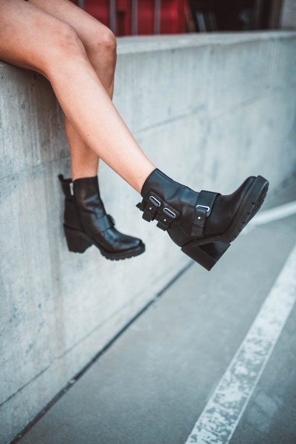 How I'm Styling Moto Boots This Fall | Greta Hollar | How I'm Styling Moto Boots This Fall by popular Nashville fashion blogger, Greta Hollar: image of a woman outside wearing Nordstrom Marc Fisher Dream Moto Boot.