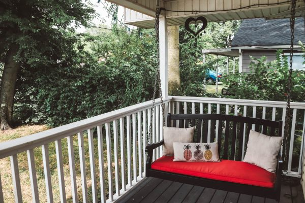 Easy and Affordable Ways to Update Your Porch | Greta Hollar | Easy and Affordable Front Porch Makeover Ideas by popular Nashville lifestyle blogger, Greta Hollar: image of a porch swing.