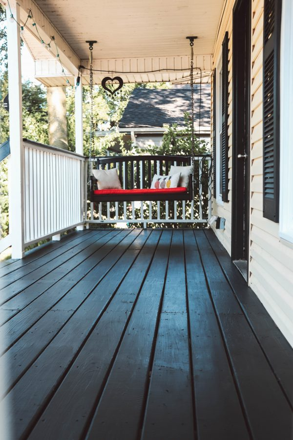 Easy and Affordable Ways to Update Your Porch | Greta Hollar | Easy and Affordable Front Porch Makeover Ideas by popular Nashville lifestyle blogger, Greta Hollar: image of a front porch painted with Sherwin Williams paint.