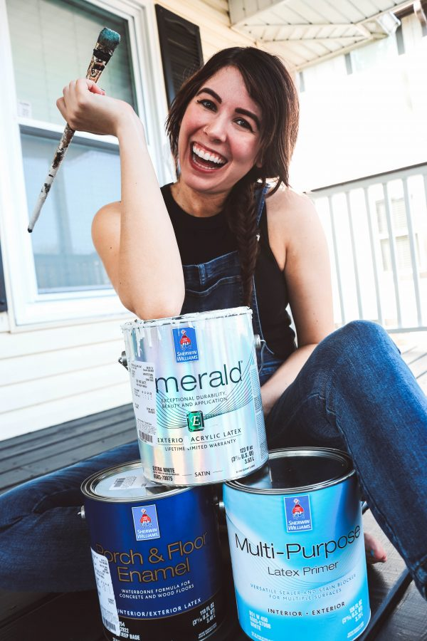 Easy and Affordable Way to Update Your Porch | Greta Hollar | Easy and Affordable Front Porch Makeover Ideas by popular Nashville lifestyle blogger, Greta Hollar: image of a sitting with open cans of Sherwin Williams paint.