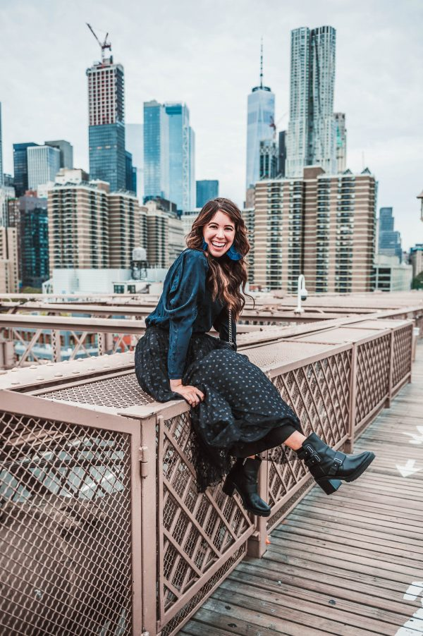 How to Get the Perfect Photo On the Brooklyn Bridge | Greta Hollar | How to Take a Picture at the Brooklyn Bridge by popular Nashville lifestyle blogger, Greta Hollar: image of a woman on the Brooklyn Bridge.