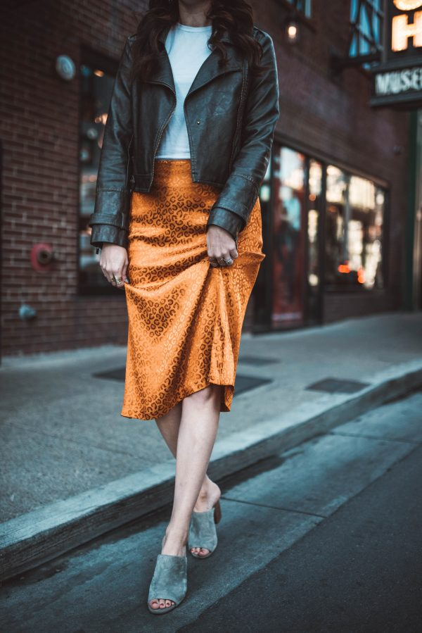 An Alternate Way to Style a Silk Skirt | Greta Hollar | Orange Clothing by popular Nashville tall fashion blogger, Greta Hollar: image of Greta Hollar wearing a orange leopard print satin skirt.